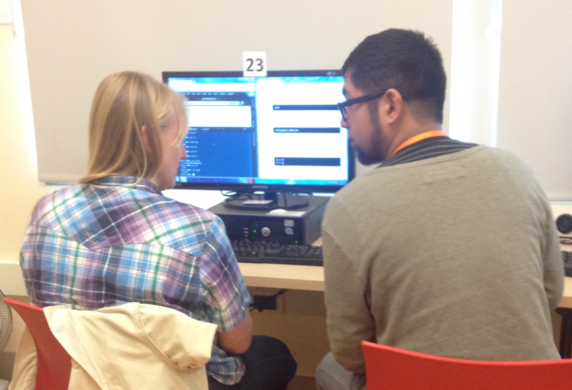 Student and teacher coding together